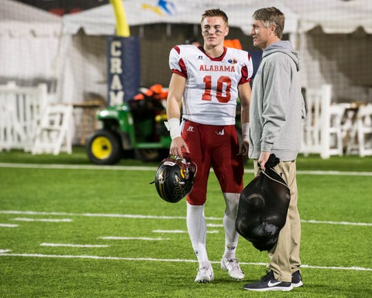 Pinson Valley's Bo Nix (10) talks with his dad and coach Patrick Nix after the Alabama-Mississippi All-Star Game at Cramton Bowl in Montgomery, Ala., on Monday, Dec. 17, 2018.
