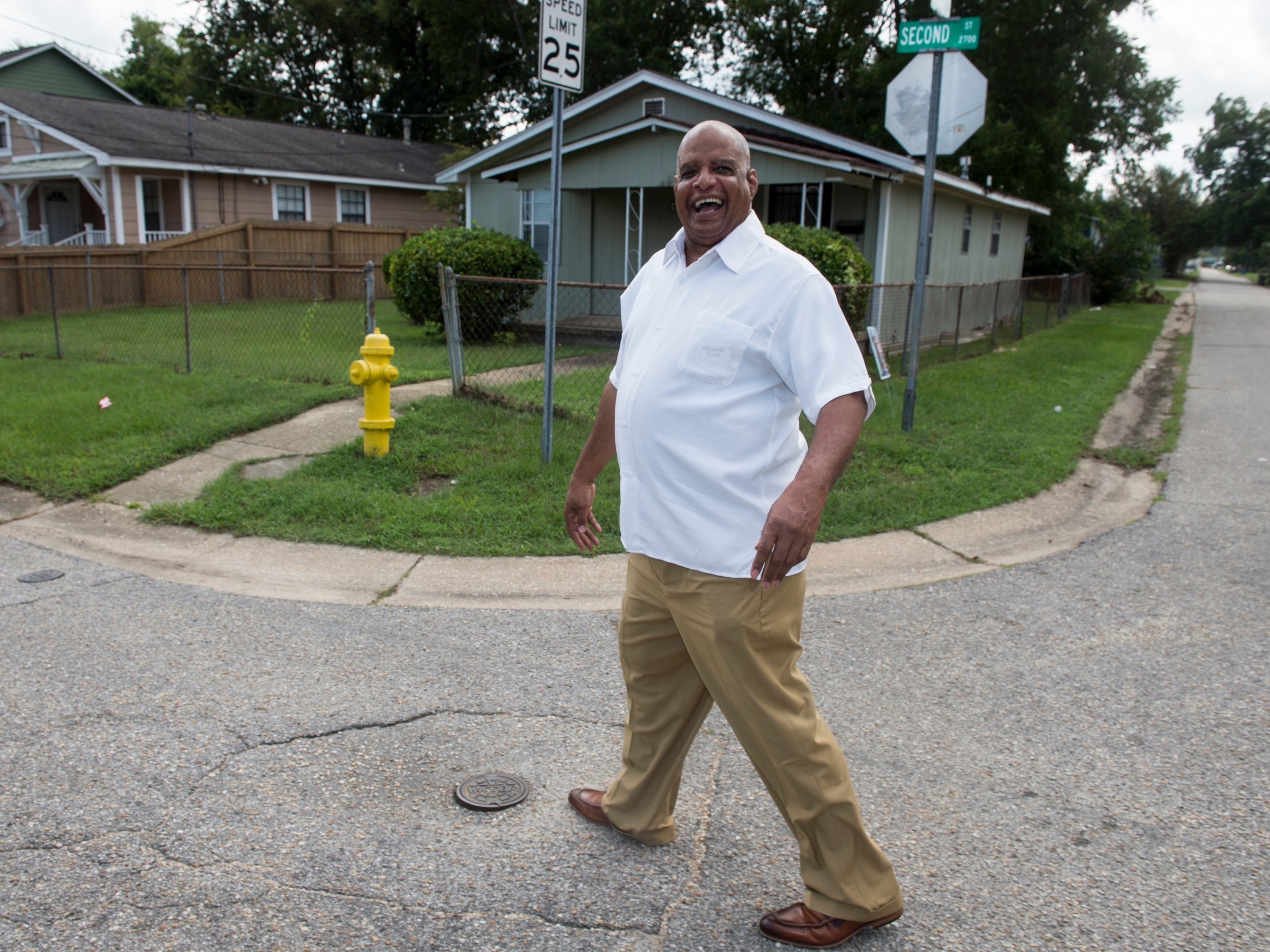 Rev. Willie Welch talks with neighbors as he walks down Second Street in Montgomery, Ala., on Monday, Sept. 10, 2018.