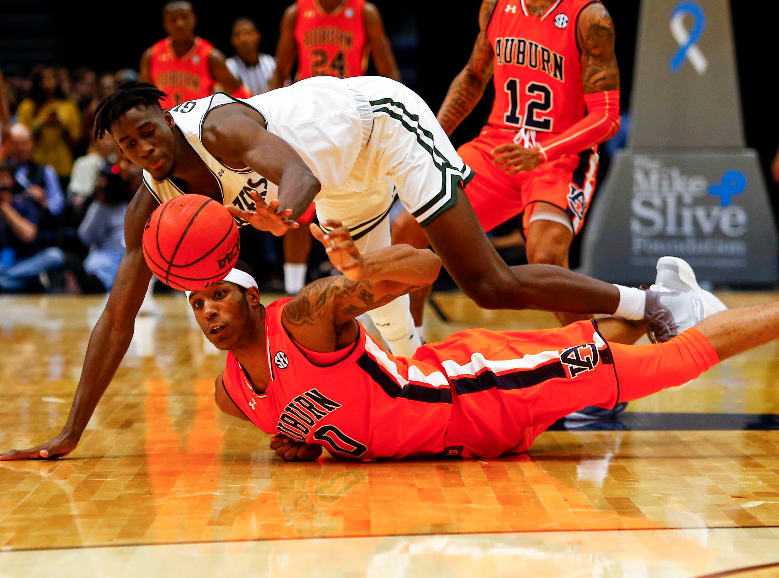 Dec 15, 2018; Birmingham, AL, USA; Auburn Tigers forward Horace Spencer (0) and UAB Blazers forward Makhtar Gueye (5) scramble for a loose ball during the second half of an NCAA basketball game at Legacy Arena. Mandatory Credit: Butch Dill-USA TODAY Sports