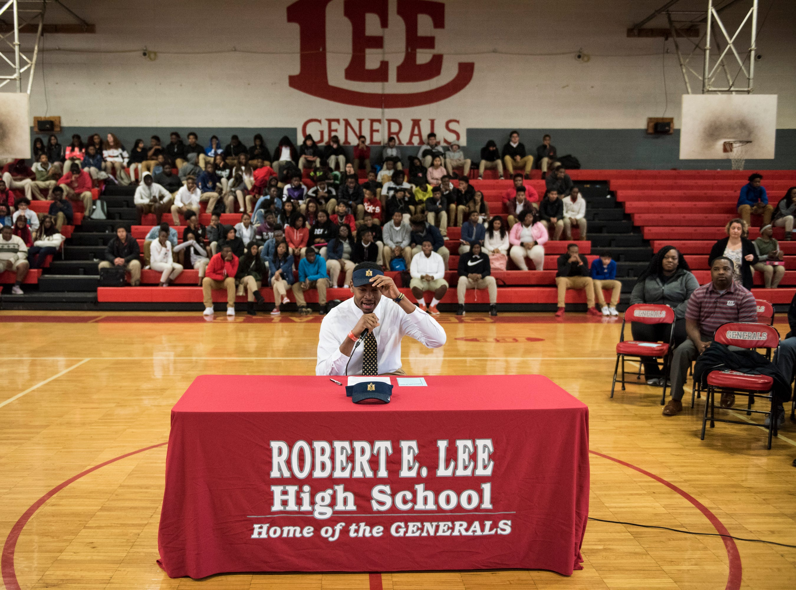 Demond Robinson adjusts his Murray State hat during signing day at Lee High School in Montgomery, Ala., on Wednesday, Nov. 14, 2018.