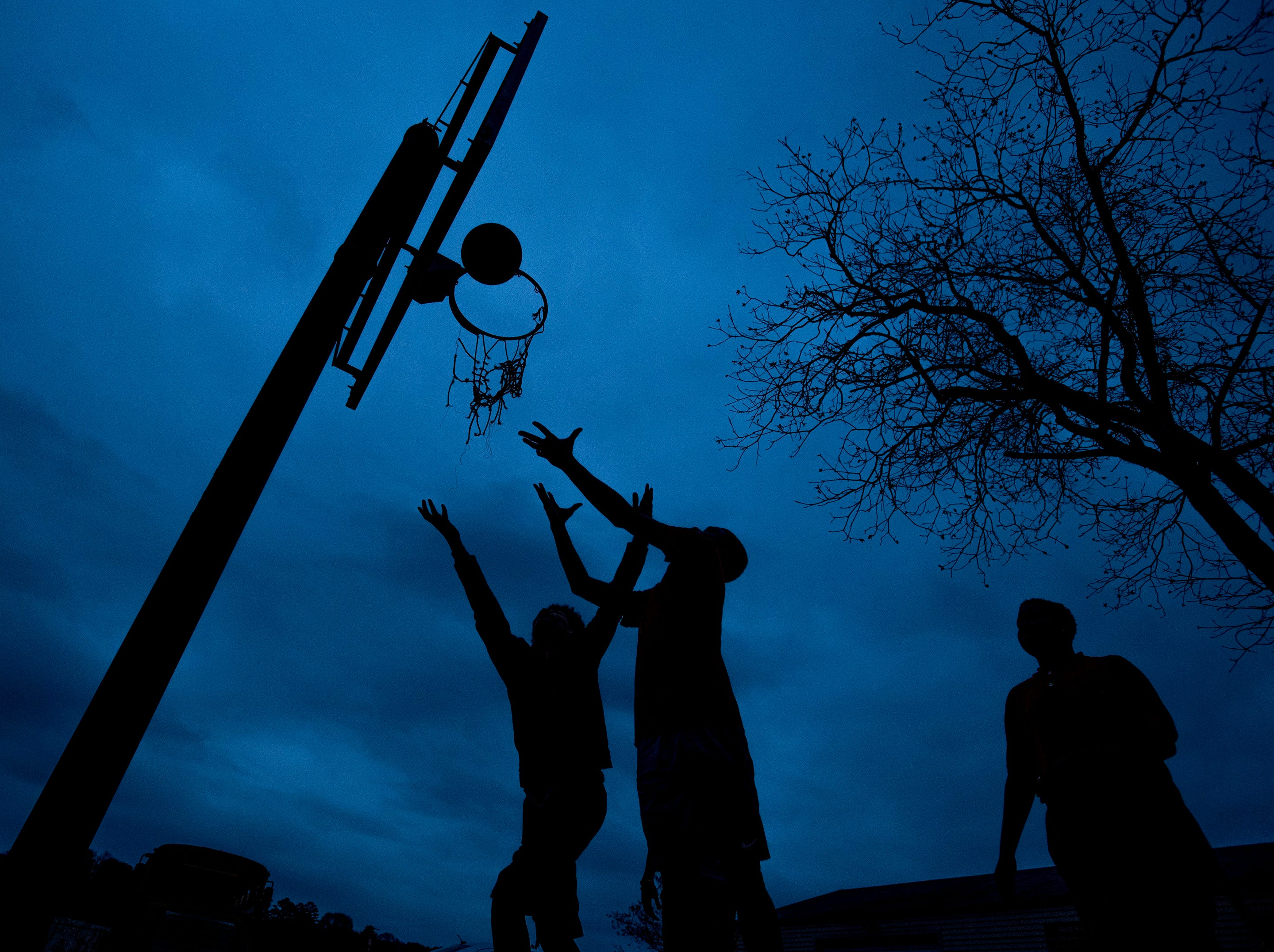 Children play basketball as the sun sets at That's My Child in Montgomery, Ala., on Wednesday January 10, 2018.