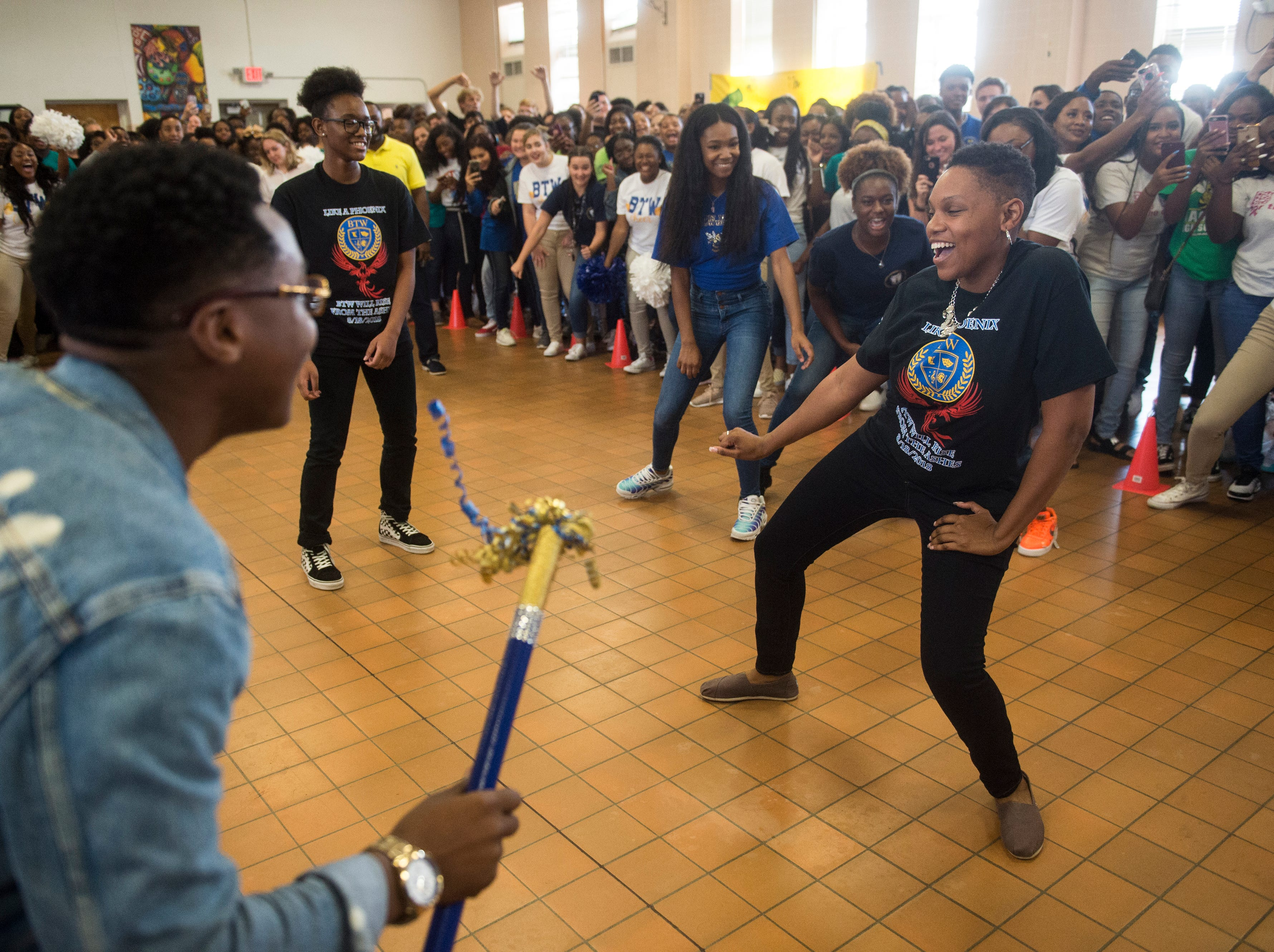 Teacher Nicole Barnett competes in the teacher-student dance off during a pep rally at BTW Magnet School at Hayneville in Montgomery, Ala., on Friday, Aug. 31, 2018.