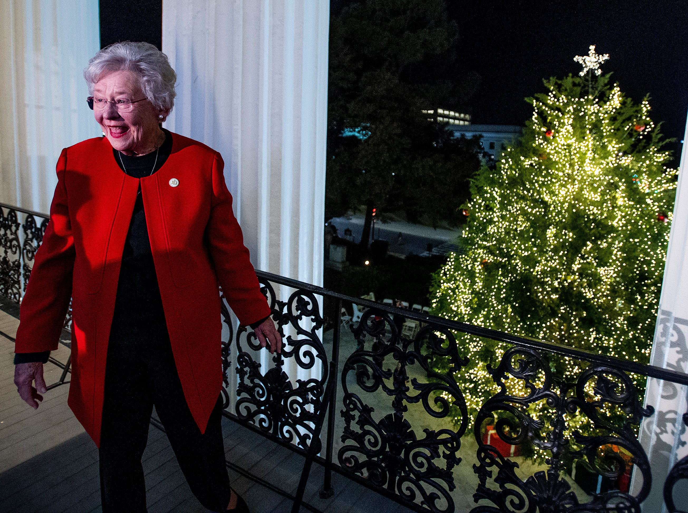 Governor Kay Ivey checks out the State Capitol Christmas Tree during the tree lighting ceremony in Montgomery, Ala., on Friday evening December 7, 2018.