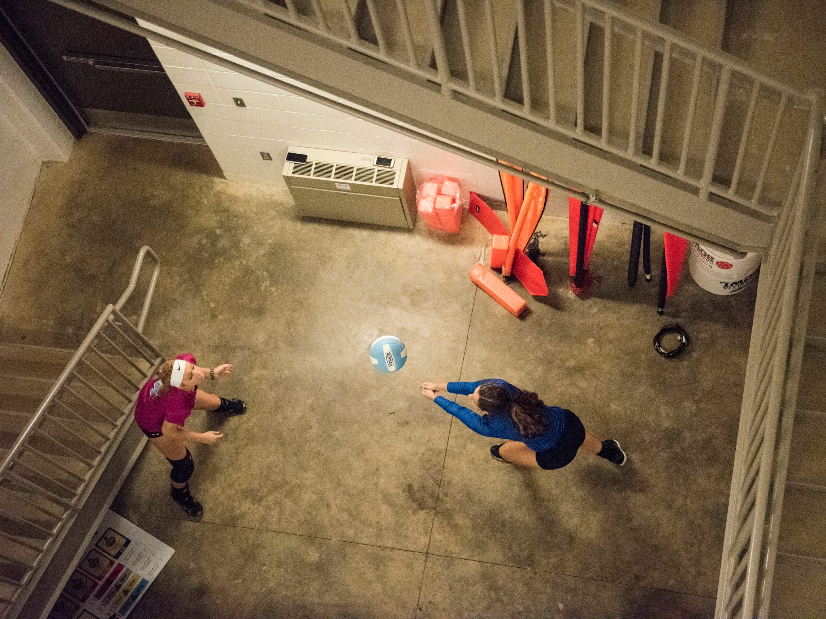 Houston Academy's Bailey Dykes, left, and Caley Caldwell practice in the stairwell during the Super Regionals at the Multiplex at Cramton Bowl in Montgomery, Ala., on Thursday, Oct. 25, 2018.