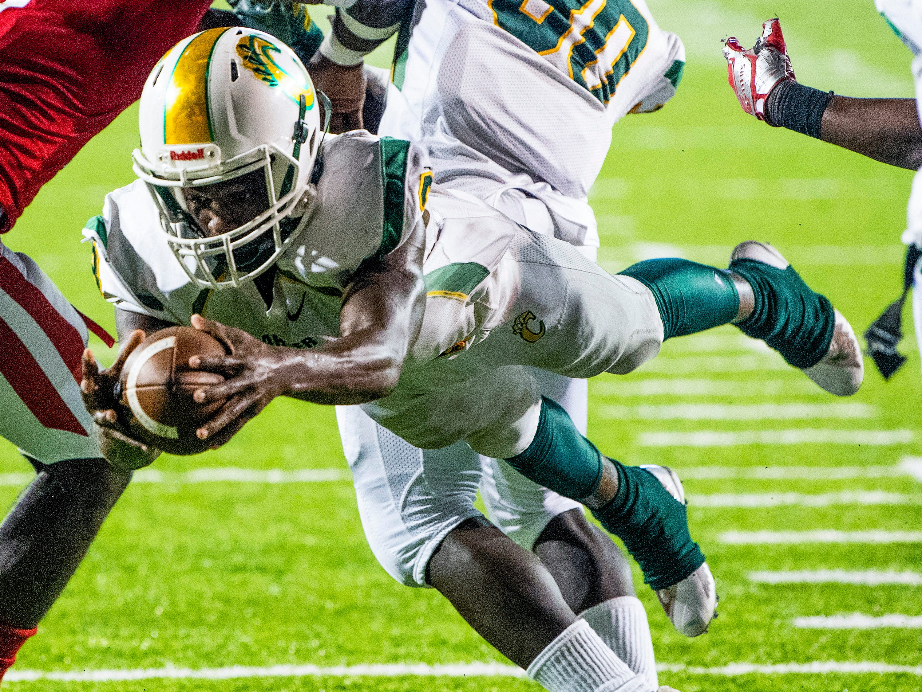Carver's Terrance Webster dives in for a touchdown against Lee in first half action at Cramton Bowl in Montgomery, Ala., on Friday September 28, 2018.