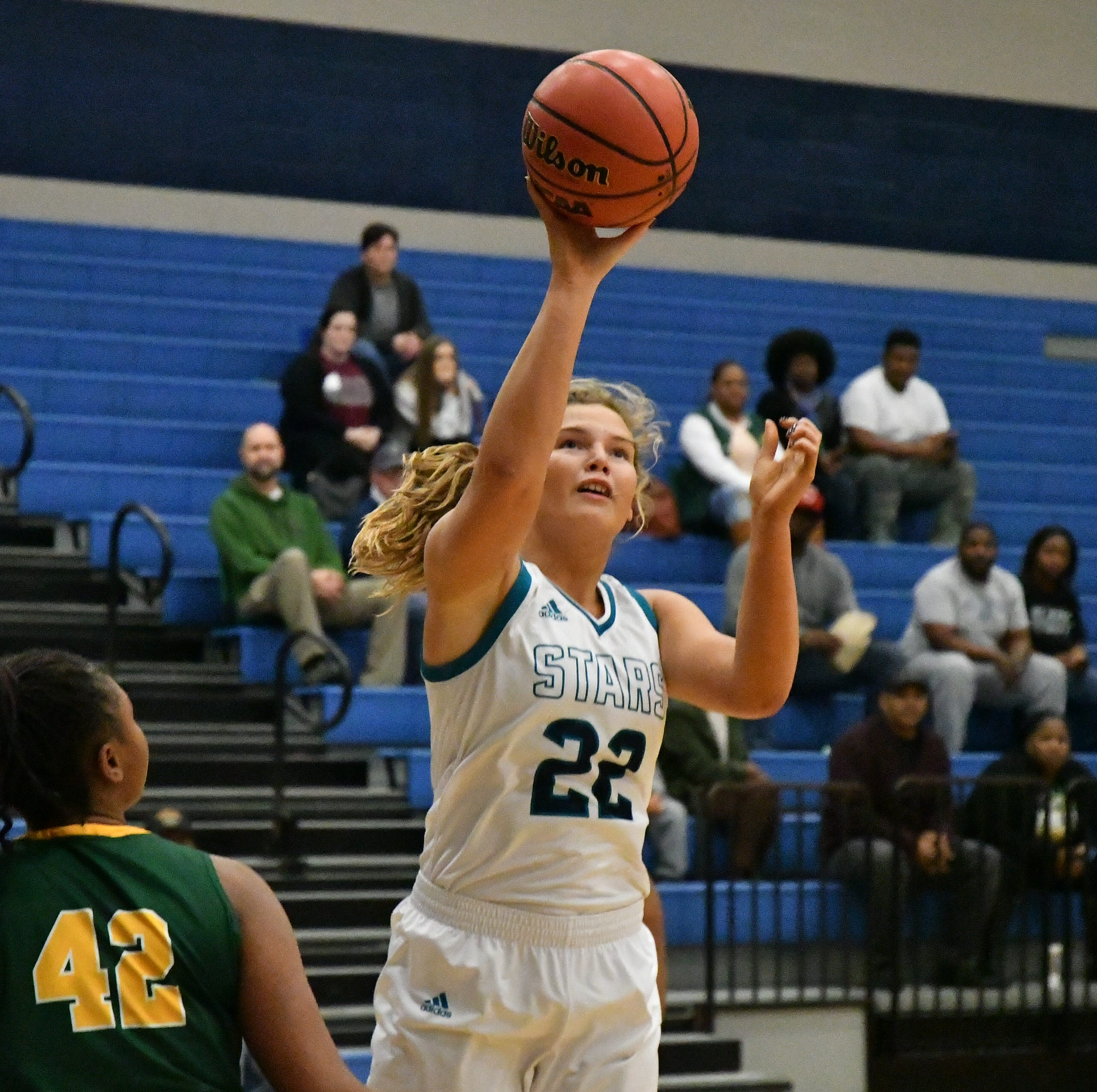 Siegel's Taylor Patterson (22) fires a jumper over Gallatin's Talor Crenshaw during Monday's game.