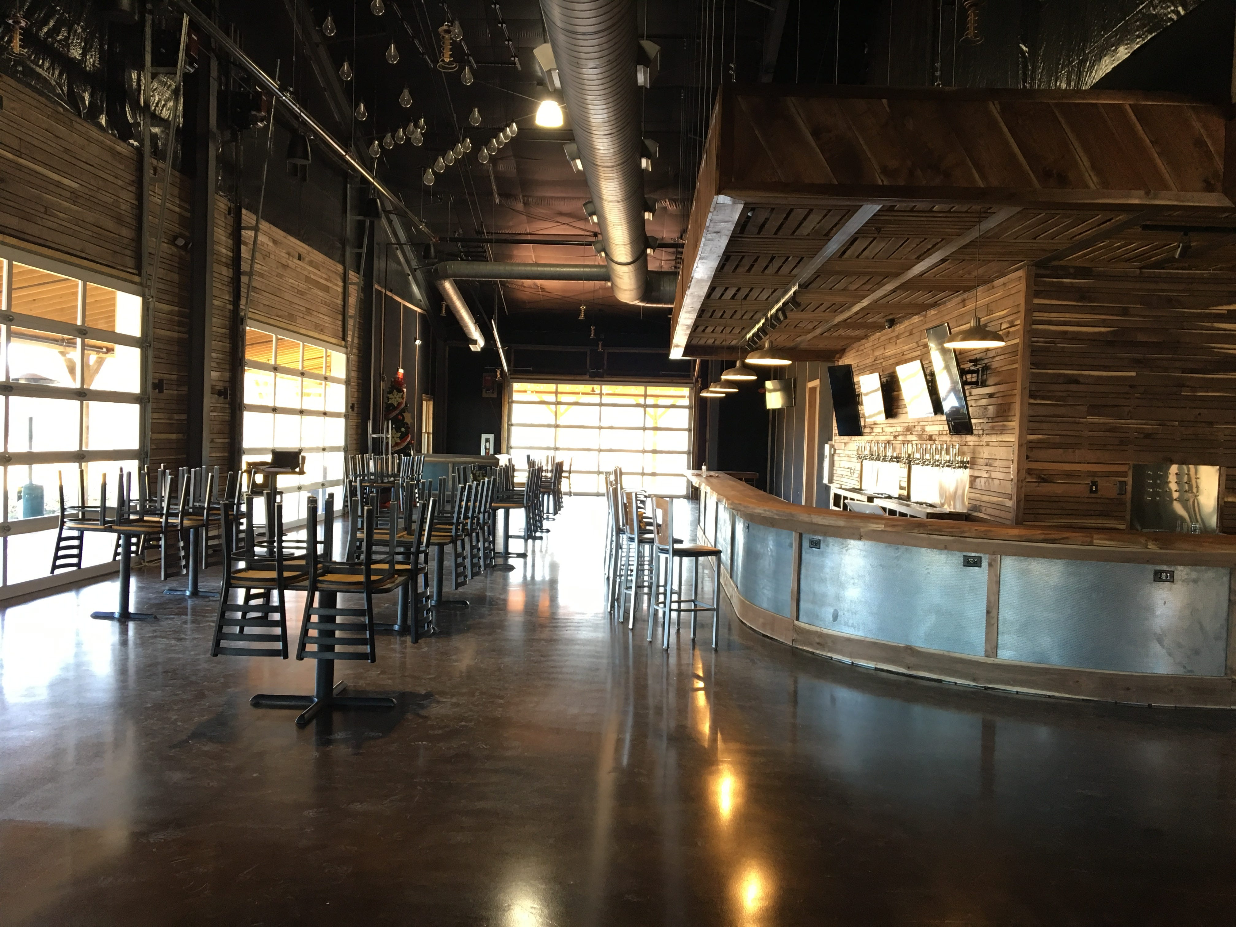 The interior of Hop Springs Taproom features walnut milled on site from trees harvested around the 83-acre property just outside of Murfreesboro city limits.
