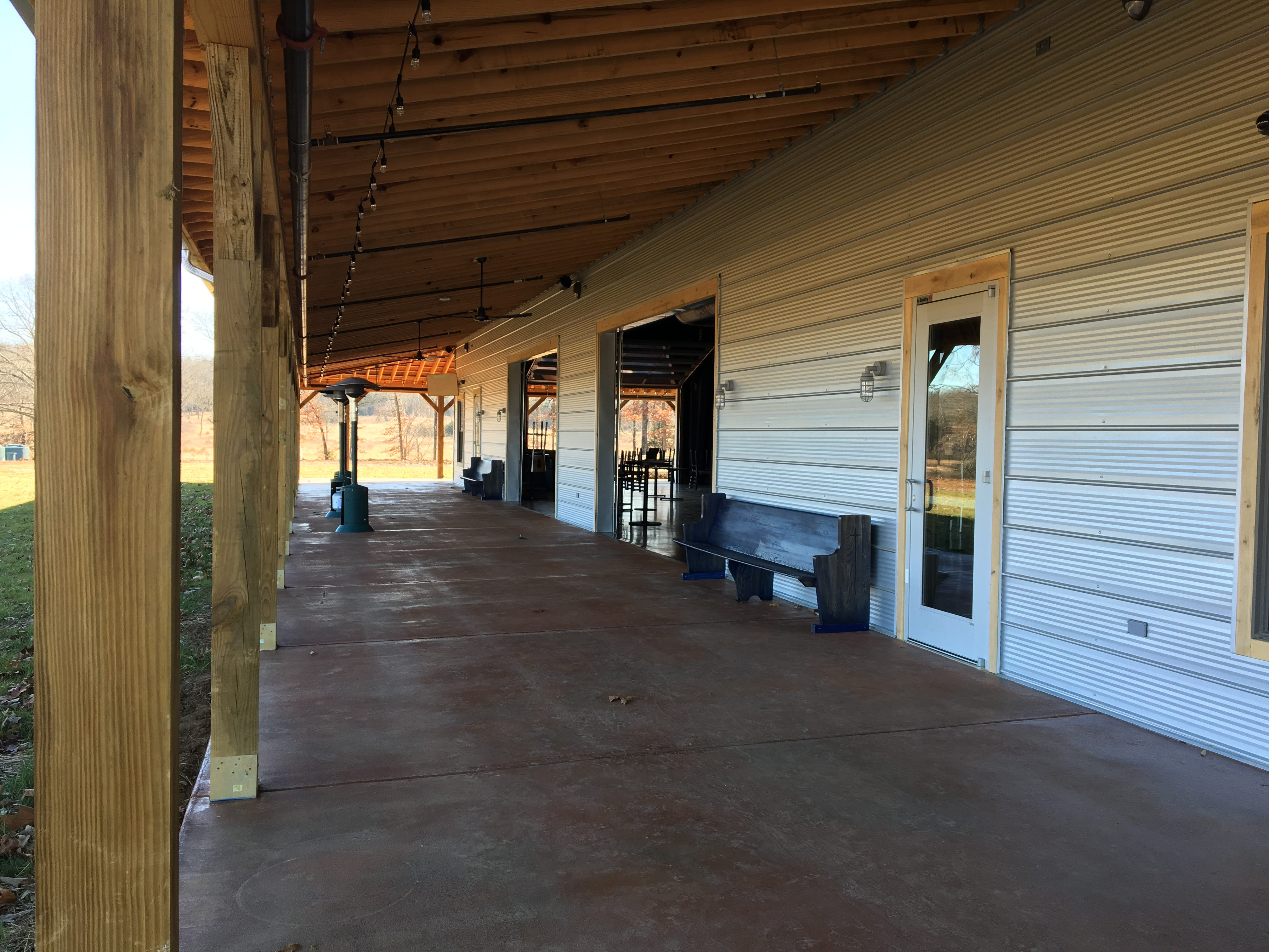 Guests at Hop Springs Taproom can enjoy the outdoors from inside the building or outside on the covered porch that overlooks the 83-acre property.