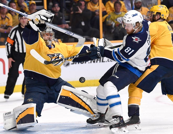 Predators goalie Pekka Rinne (35) makes a stop by Jets left wing Kyle Connor (81) in front of the net during the second period in Game 2 of the second round NHL Stanley Cup Playoffs at the Bridgestone Arena Sunday, April 29, 2018, in Nashville, Tenn.