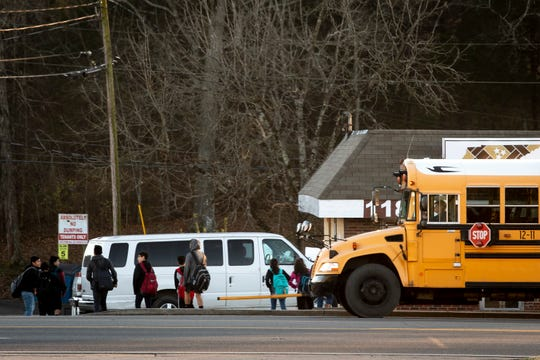 Children depart from a stopped school bus on Lebanon Rd. in Mt. Juliet, Tenn., Tuesday, Dec. 18, 2018.