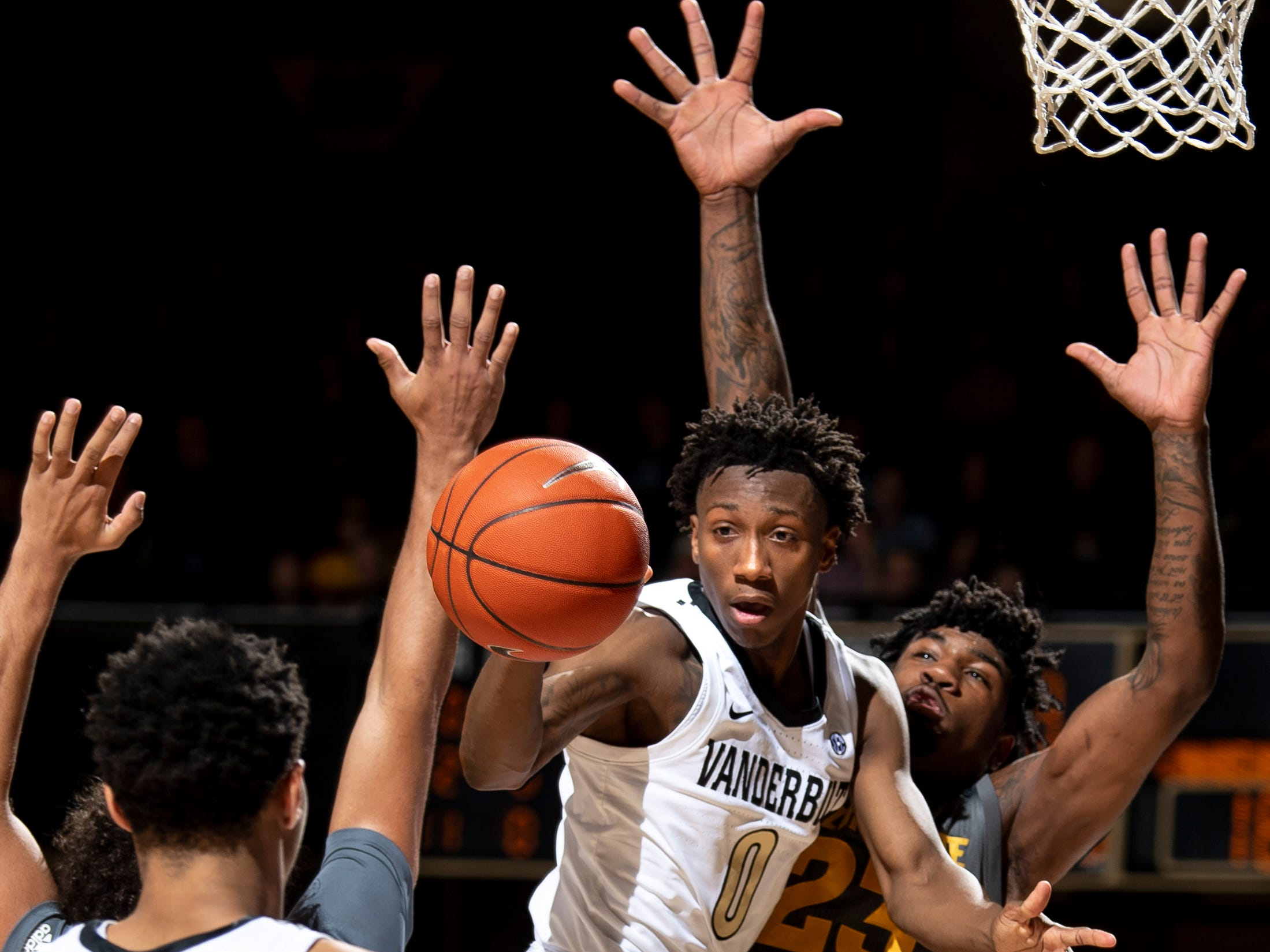 Vanderbilt guard Saben Lee (0) passes past Arizona State forward Romello White (23) during the first half at Memorial Gym in Nashville, Tenn., Monday, Dec. 17, 2018.
