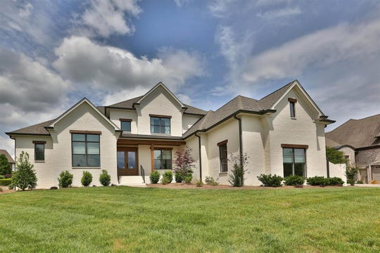 112 Bell Harbor in Hendersonville is a five bedroom, five bathroom 5,357 square foot lake home