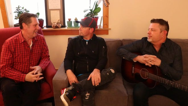 Bart Herbison, left, talks to songwriters Chris Tompkins and Rodney Clawson.