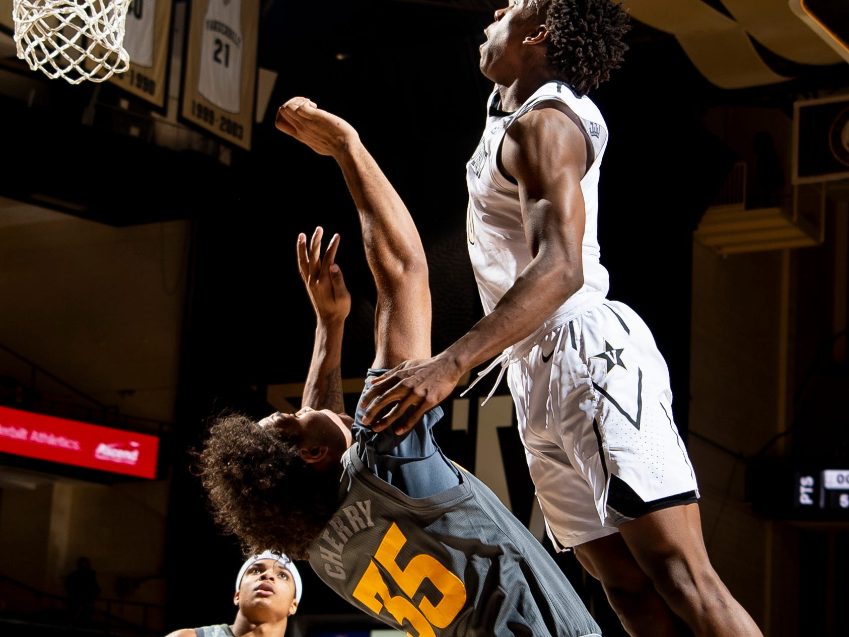 Vanderbilt guard Saben Lee (0) is fouled by Arizona State forward Taeshon Cherry (35) during the second half at Memorial Gym in Nashville, Tenn., Monday, Dec. 17, 2018.