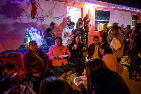 A Las Posadas celebration concludes with a community dinner and live music Sunday, Dec. 16, 2018, at a home in Immokalee.