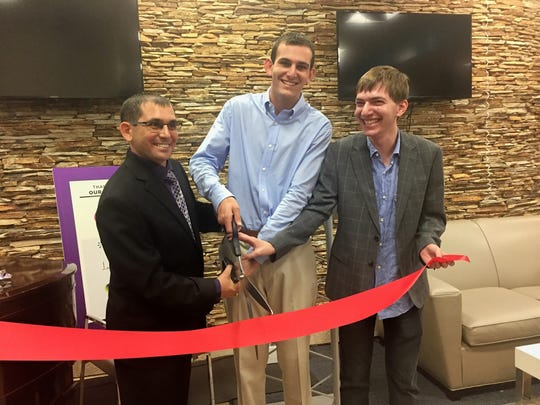 Danny Rosenfeld, who runs the Naples Epilepsy Resource Center, Jacob Wolfe, and Michael Weinstein prepare to cut the ribbon during the grand opening of the Naples Epilepsy Resource Center on Nov. 15, 2017.