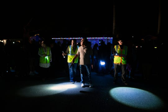 Juan Martinez, center, and volunteers guide vehicles past participants in the Las Posadas procession down Breezewood Drive on Sunday, Dec. 16, 2018, in Immokalee.