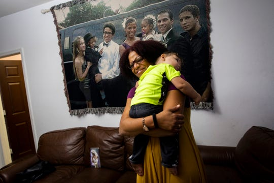 Aloima Cata hugs her son Renzo Sander Lorenzo, 1, on Friday, Dec. 14, 2018, at their home in East Naples. Cata and her husband officially adopted Renzo in November, but he has been living with them since he was a newborn.