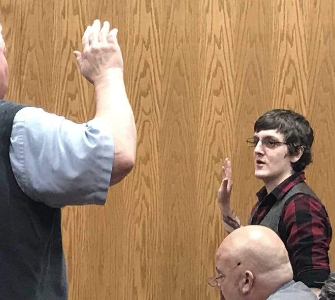 Noah McFarland (right) is sworn in for a plea hearing Tuesday morning in Judge David Branstool's courtroom.