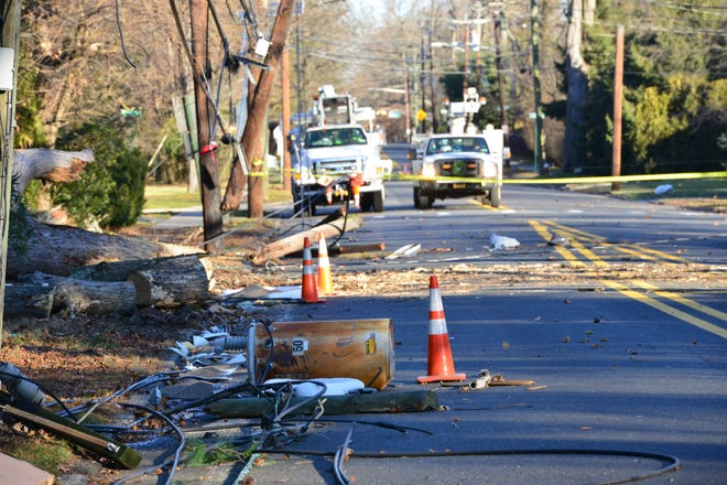 A tree fell across utility lines bringing down live arcing wires, a transformer and breaking a utility pole on Knickerbocker Rd in Tenafly, on Tuesday in the early morning hours December 18, 2018.