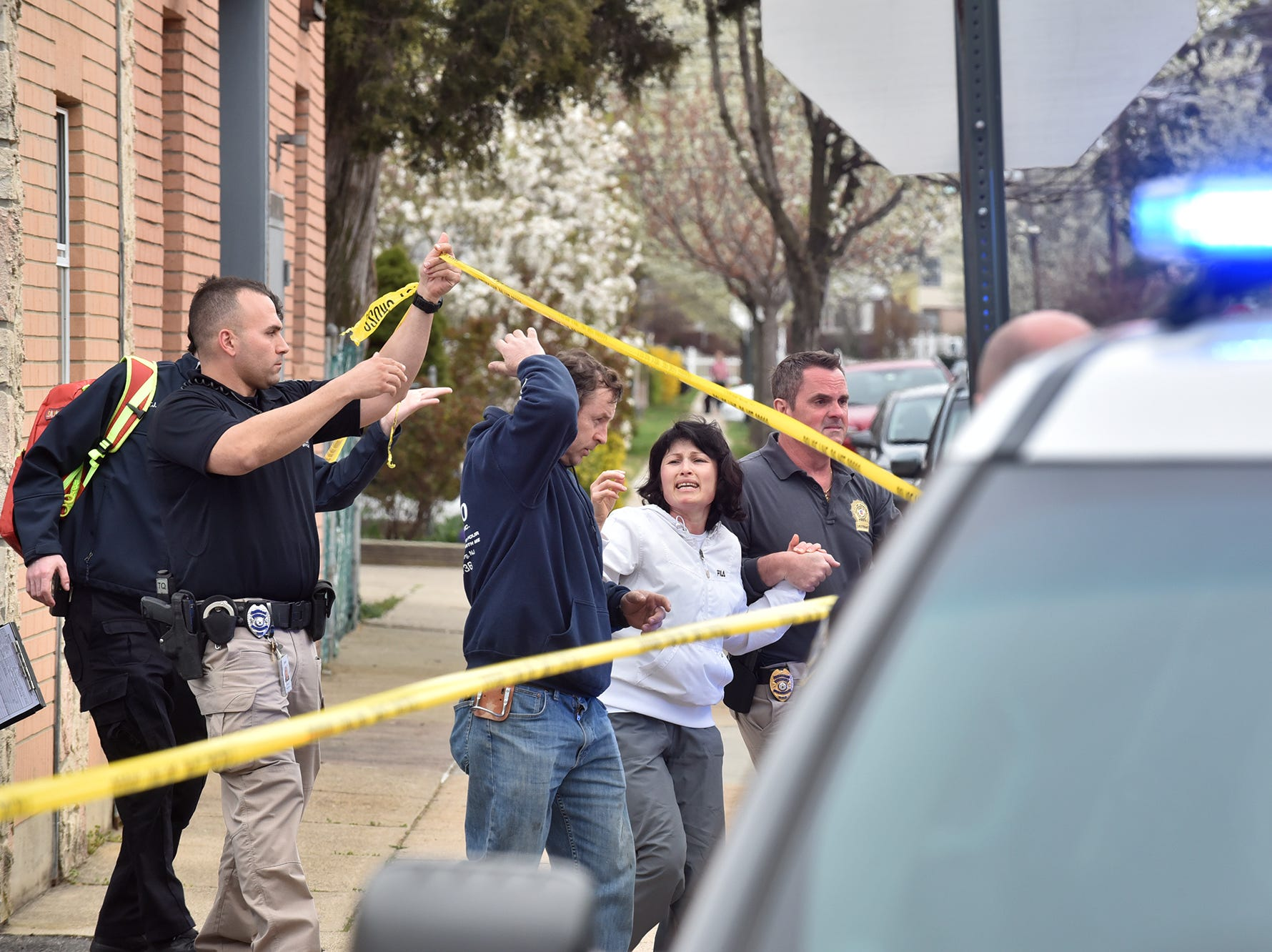 BREAKING NEWS An unidentified mother of a child who got fatally run over by a vehicle, is taken away upon arriving on the scene of the accident in Garfield, NJ.