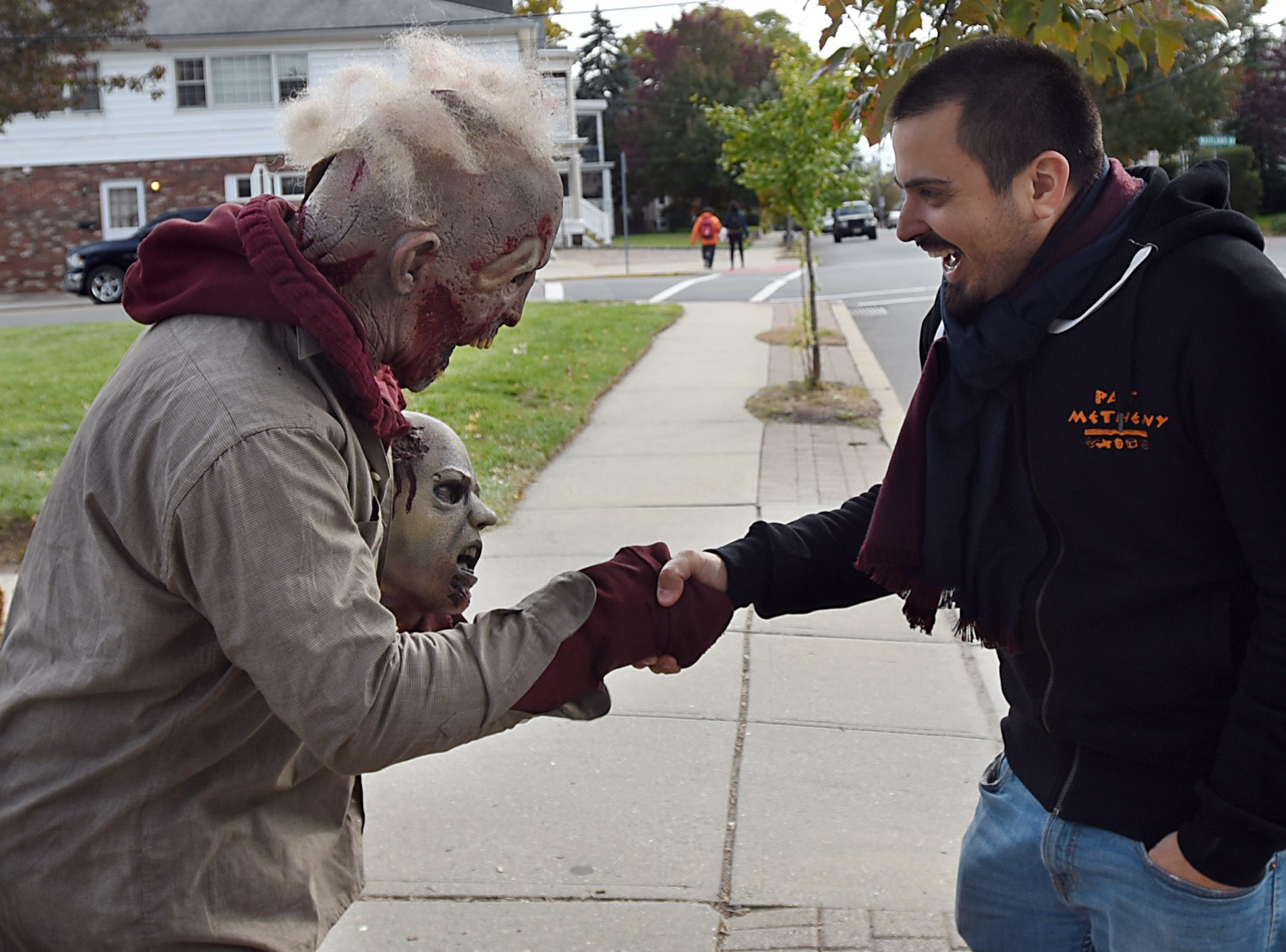 Antonio Rodrigues goes all out for Halloween decorating his home with hundreds of spooky creatures. Dressed as a zombie Antonio Rodrigues shakes the hand of Ryan Sebastian Nigro in Hawthorne on Friday October 26, 2018.