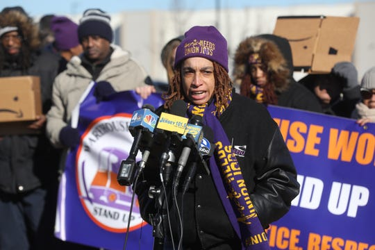 Yadhira Alvarez of the SEIU, addresses the media as she protests with other labor advocates outside the Amazon Fulfillment warehouse in Robbinsville, New Jersey on December 18, 2018 to demand better protections for those working in Amazon warehouses.