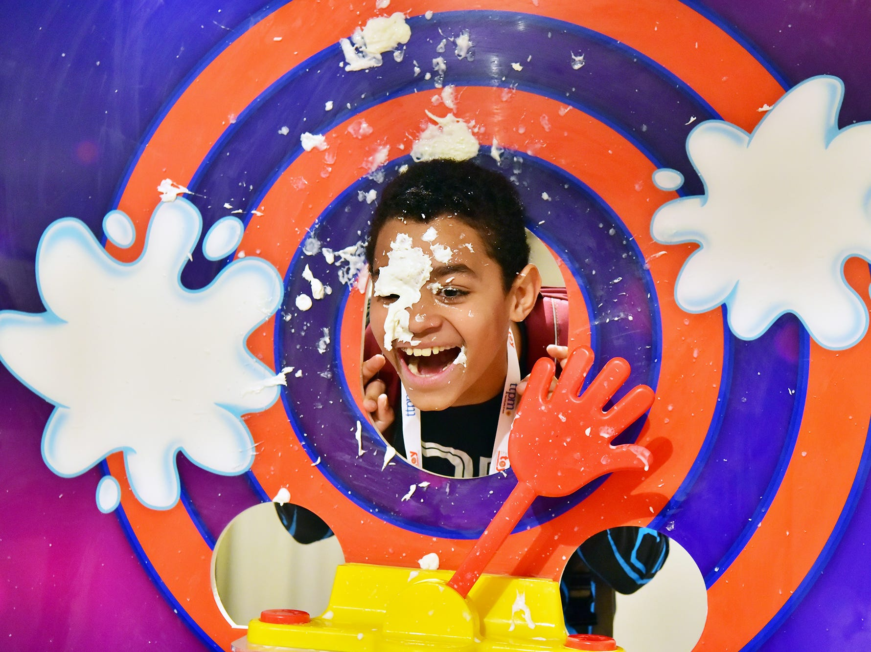"""BUSSINES/MONEY: William Yarde, 10, of Maplewood, NJ, gets hit with wiped cream launched from a """"Pie Face Cannon"""" at the TTPM Spring Toy Showcase in New York, NY., on Thursday, April 26."""