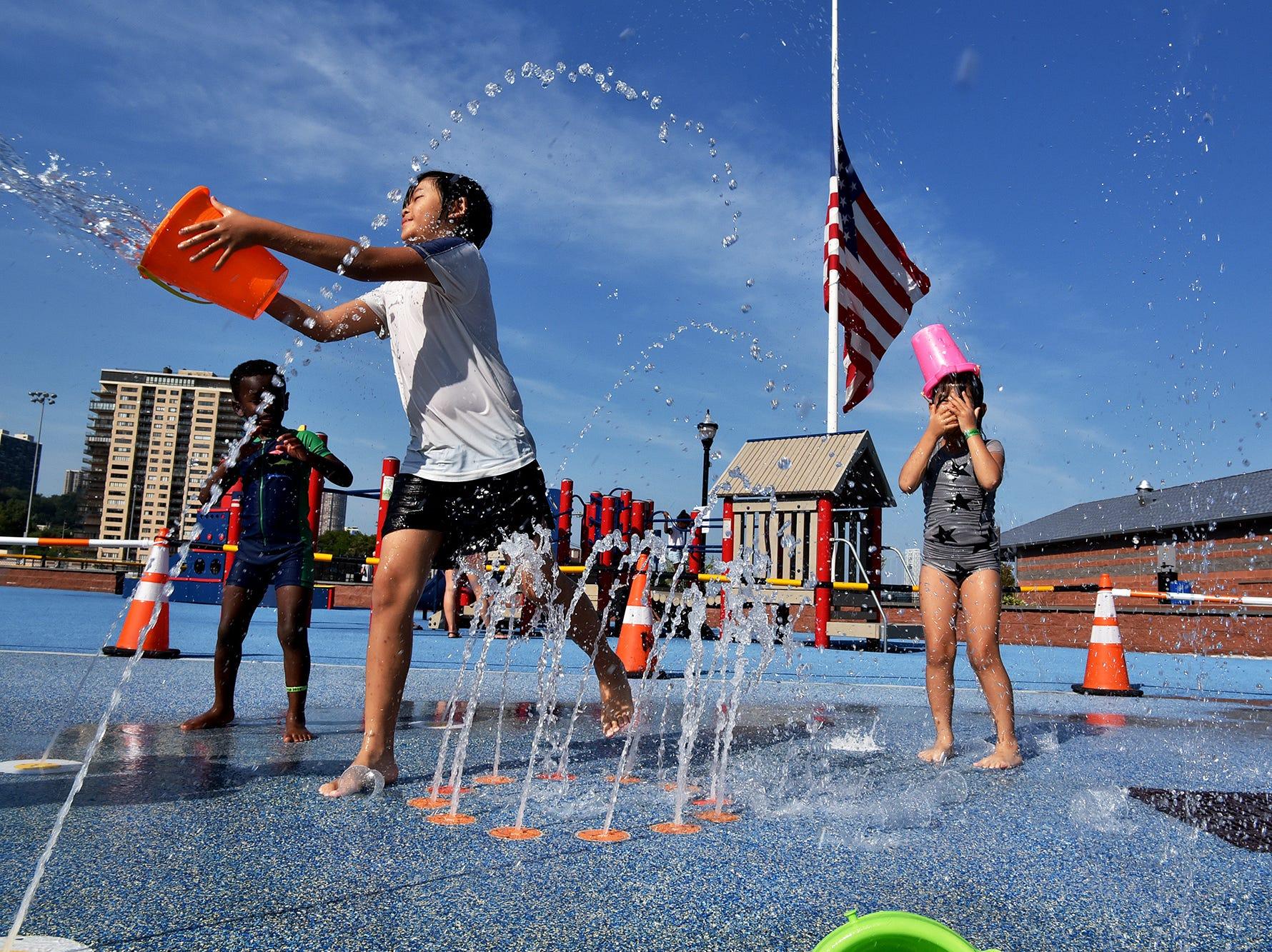 WEATHER Children play at the sprinklers at Veterans Memorial field in Edgewater, NJ.