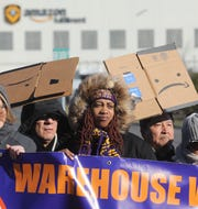 Tamara Clay, center, is one of the labor advocates protesting outside the Amazon Fulfillment warehouse in Robbinsville, New Jersey on December 18, 2018 to demand better protections for those working in Amazon warehouses.