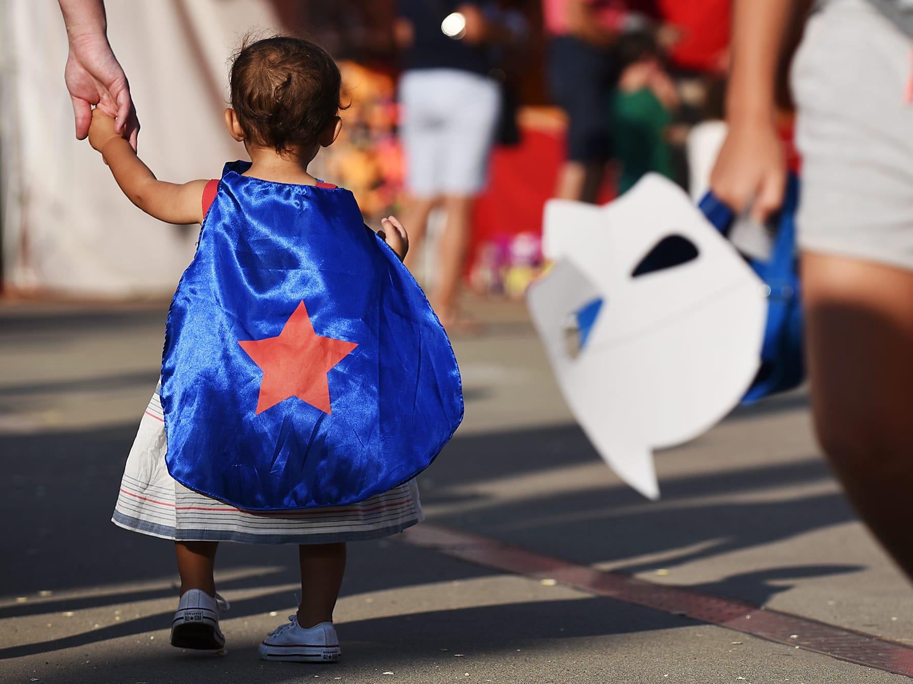 A tiny Superhero participates in Superhero Night at Yogi Berra Stadium in Little Falls  on Saturday July 28, 2018.