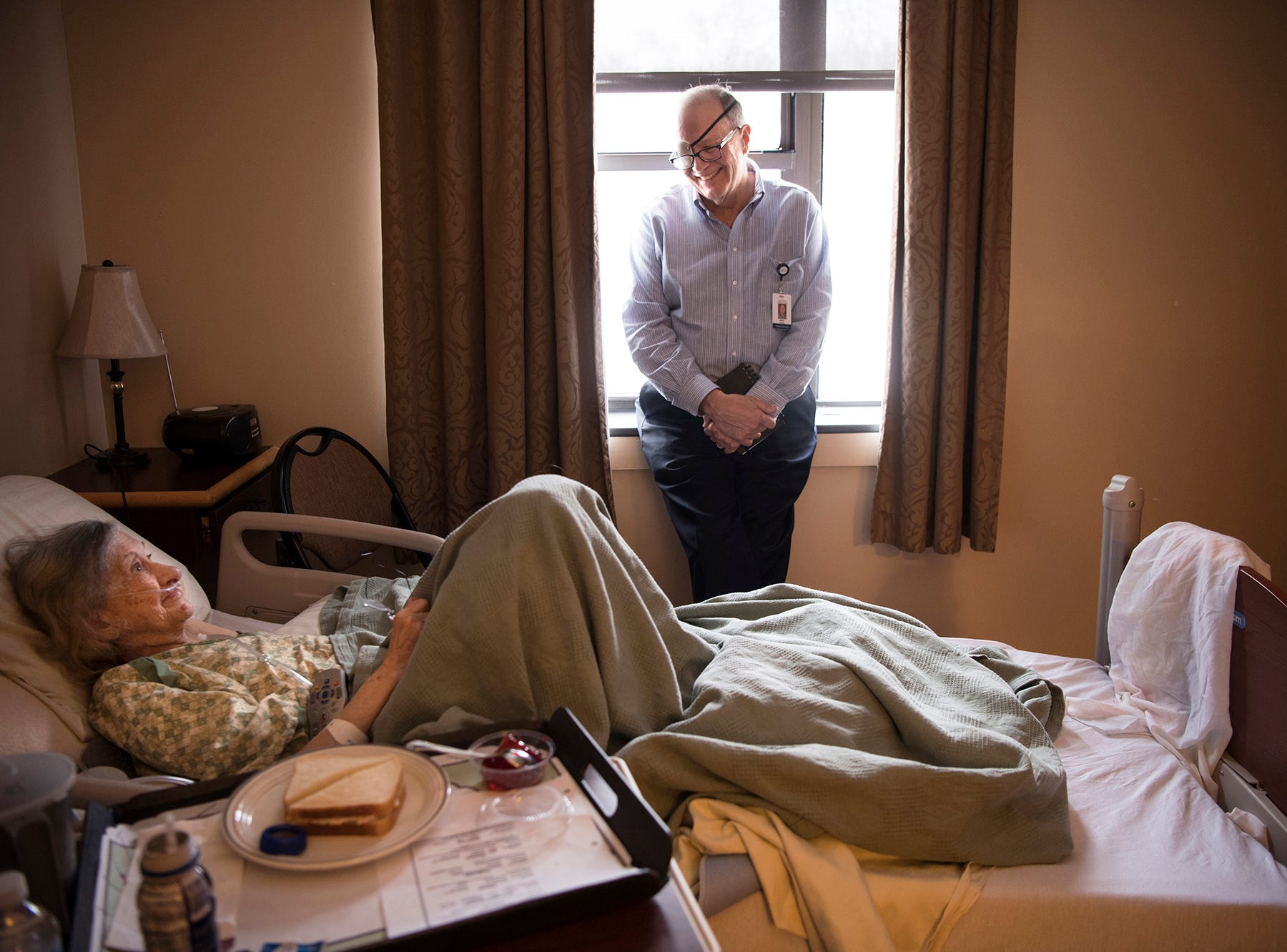 Dave Woods has been diagnosed with terminal cancer. He , volunteers at Villa Marie Claire, the same hospice center where he wishes to die. Woods talks with Nettie in her room at Villa Marie Claire on Wednesday, February 7, 2018. KARASPOY2018
