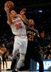 New York, NY, USA; New York Knicks forward Kevin Knox (20) drives to the basket past Phoenix Suns forward Richaun Holmes (21) during the second half at Madison Square Garden.