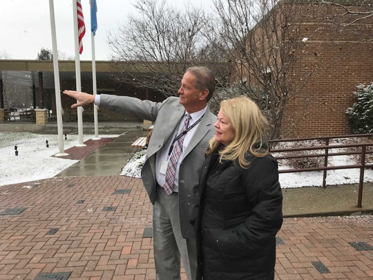 Richard Blohm, director of the Bergen County Law and Public Safety Institute, points out buildings deflecting sound to Bergen County Freeholder Mary Amoroso of Mahwah.