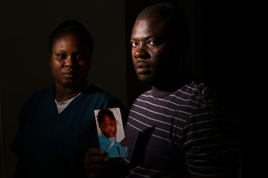 Ocroimy Dolcin and his wife, Modeline Auguste, pose with a photo of their daughter, Dorcase Dolcin, who was one of at least ten people who died, at the Wanaque Center for Nursing and Rehabilitation last month of an adenovirus outbreak. Thursday, November 1, 2018