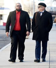 Former Paterson police officer Jonathan Bustios, on left, leaves the Federal District Courthouse in Newark, with his attorney Michael Koribanics, after pleading guilty to charges of extortion and conspiracy to deprive persons of their human rights on Tuesday, December 18, 2018.