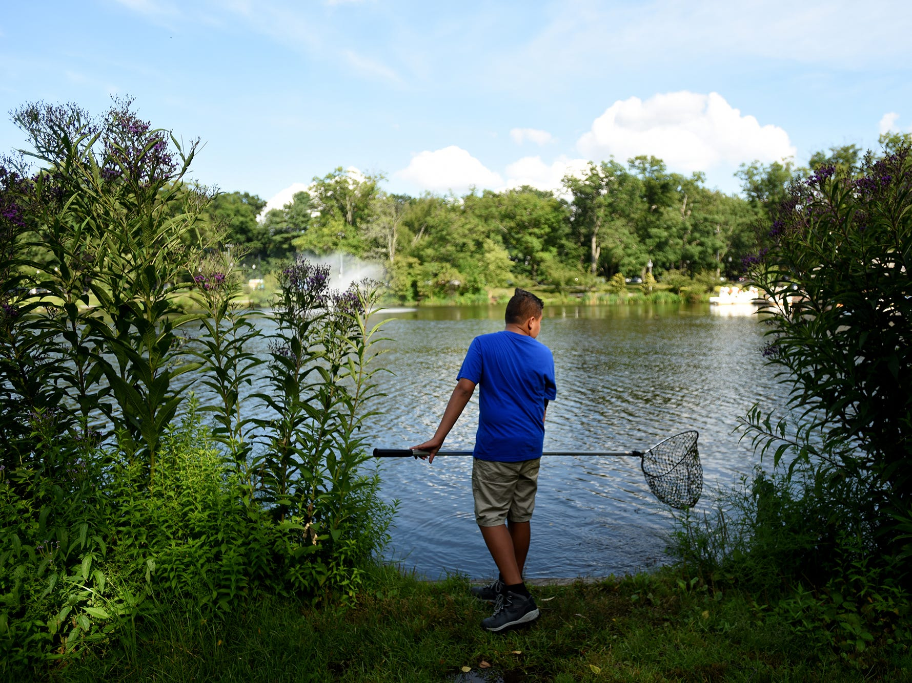 Sam Ibold, 12, is sometimes harassed for catching frogs in Verona Lake. Shown in Verona, NJ on Wednesday August 1, 2018.