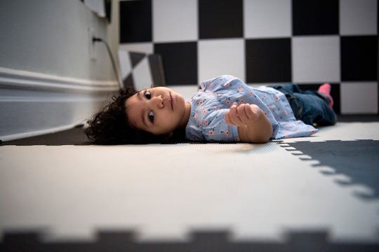Darah, 1, was born with microcephaly after exposure to the Zika virus. Darah lies on her back in a room with black and white patterns on the floor and walls which her mother hopes will help strengthen her vision at their apartment on Saturday, March 3, 2018.