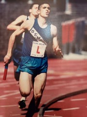 Class of 1997 member Mike Pasciuto running track for NV/Demarest.