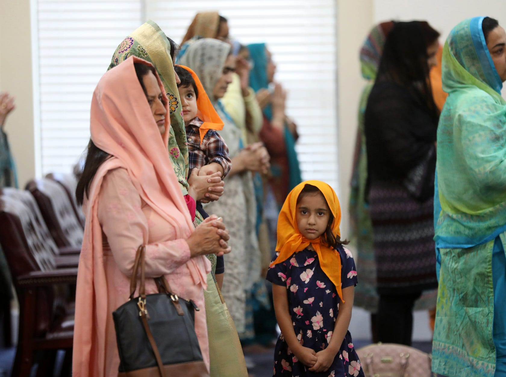 People are shown at Guru Nanak Sikh Mission, in Oakland, during Sunday prayers, August 19, 2018.