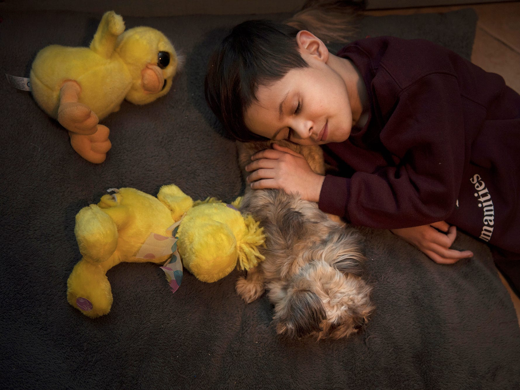 Jacob Rodriguez, 7, with his dog Brownie on Wednesday, January, 24, 2018. Jacob has muscular dystrophy, his dog went missing and was recently found and returned to him.