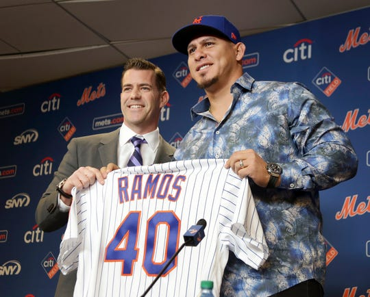 New York Mets general manager Brodie Van Wagenen, left, poses with catcher Wilson Ramos during an introductory news conference at Citi Field, Tuesday, Dec. 18, 2018, in New York.