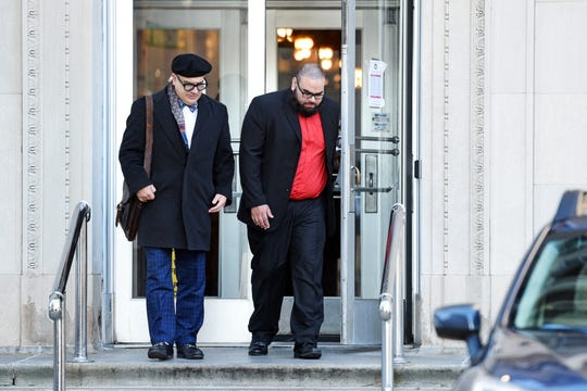 Former Paterson police officer Jonathan Bustios, on right, leaves the Federal District Courthouse in Newark, with his attorney Michael Koribanics, after pleading guilty to charges of extortion and conspiracy to deprive persons of their human rights on Tuesday, December 18, 2018.