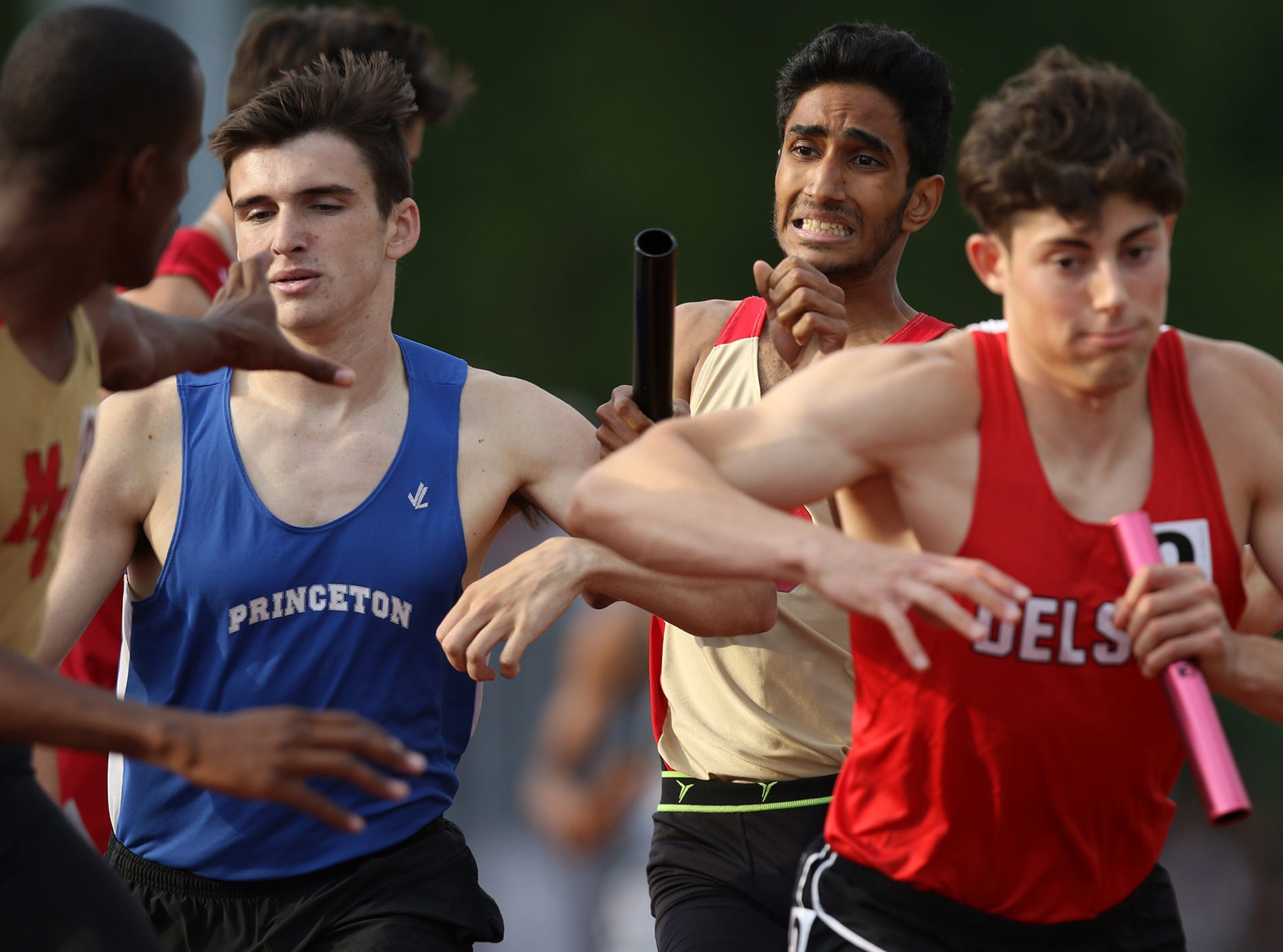 Jaymin Mistry, of Mount Olive, tries to get the baton to Nashawn Vazquez for the anchor leg.  The team came in second place with a time of 7:47. Saturday, June 9, 2018