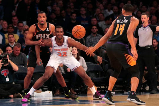 Dec 17, 2018; New York, NY, USA; New York Knicks forward Noah Vonleh (32) loses the ball to Phoenix Suns guard De'Anthony Melton (14) during the first half at Madison Square Garden.