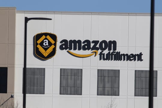Labor advocates protest outside the Amazon Fulfillment warehouse in Robbinsville, New Jersey on December 18, 2018 to demand better protections for those working in Amazon warehouses.