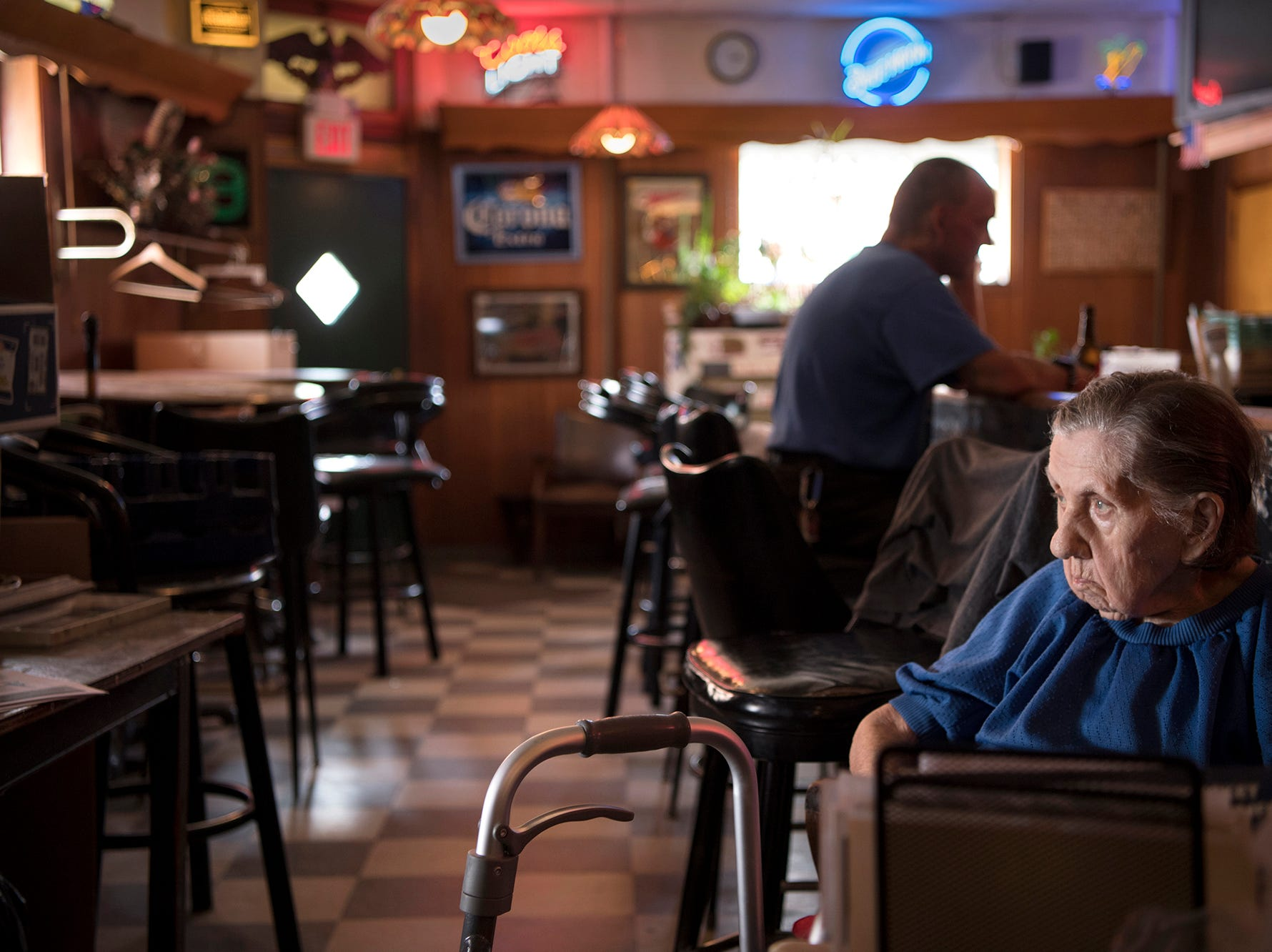 Emily Penkalski, 96, has owned and run Johnny's for 65 years.  Emily in her bar on Tuesday, July 17, 2018. KARASPOY2018