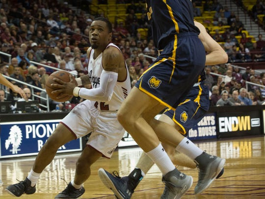 New Mexico State University's AJ Harris and the Aggies open WAC play on Thursday at California-Baptist.