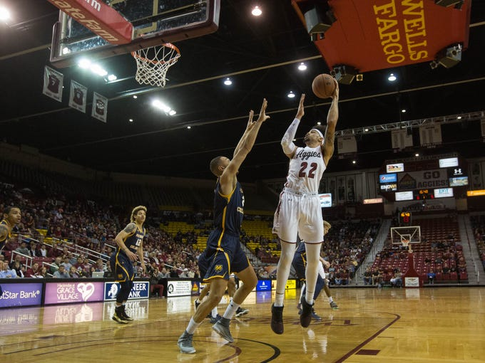 New Mexico State Univeristy's Eli Chuha, shoot over Northern Colorado's Kai Edwards. Monday December 17, 2018 at the Pan American Center.