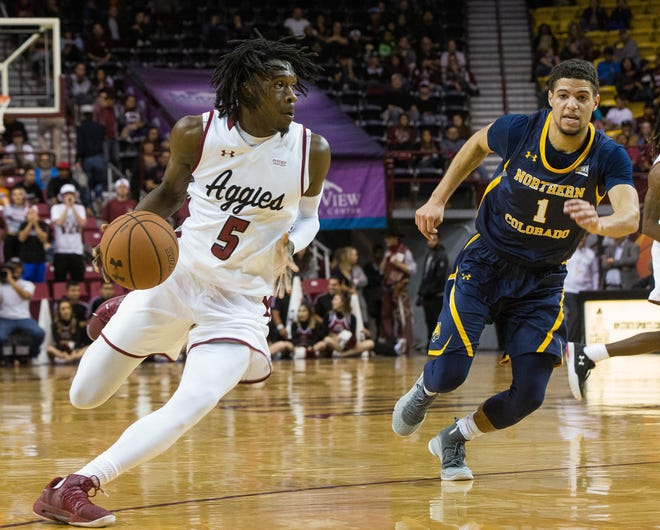Clayton Henry, drives down court againt the University of Northern Colorado, Monday December 17, 2018 at the Pan American Center.